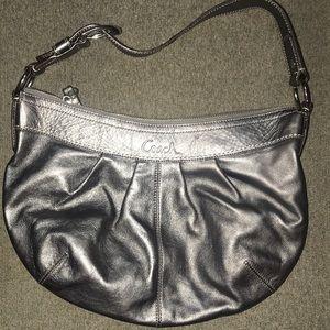Grey/platinum leather coach handbag